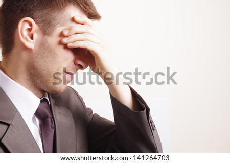 man with suit having stress isolated on white background - stock photo