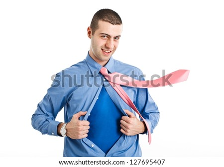 Man with superhero suit under his shirt - stock photo