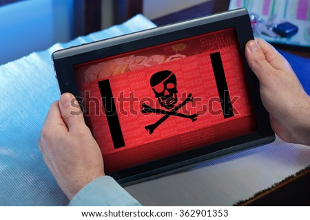 man with tablet at home watching your web page with a cyber attack / hands of a man consulting in touchscreen a hacked website  - stock photo