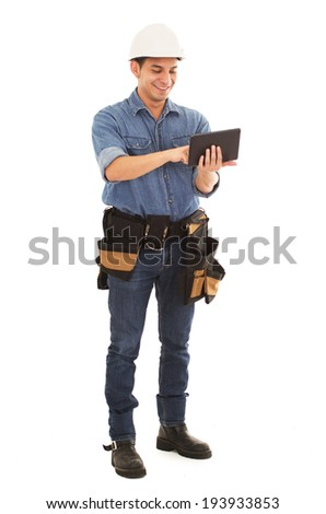 man with tablet, hard hat and pipes on a white background - stock photo