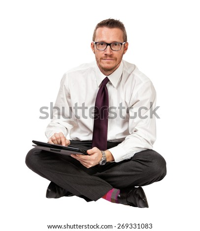 man with tablet isolated on white background - stock photo