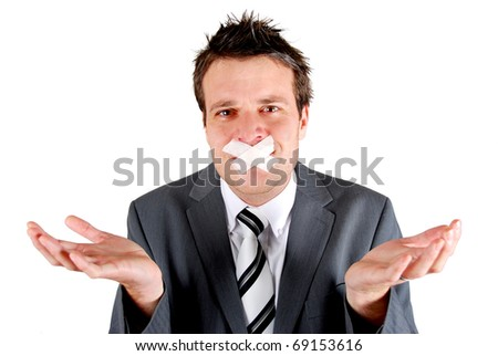 Man with tape over his mouth in a gesturing pose of speechlessness - stock photo