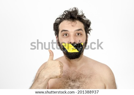 Man With Tape Over His Mouth - Secrets Or Silence - Thumbs Up - Isolated On White / Man - Secrets - Silence - Thumbs Up - stock photo