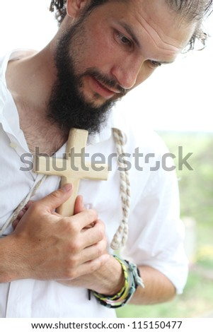 Man with the cross - stock photo