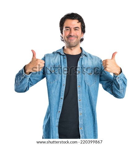 Man with thumb up over white background - stock photo