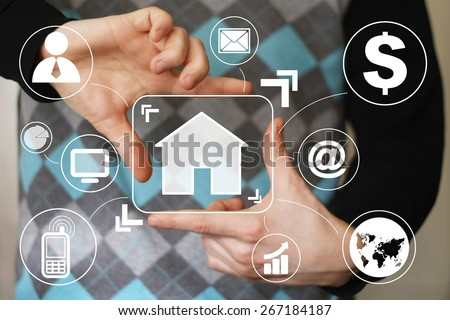 Man with touchscreen house network virtual - stock photo