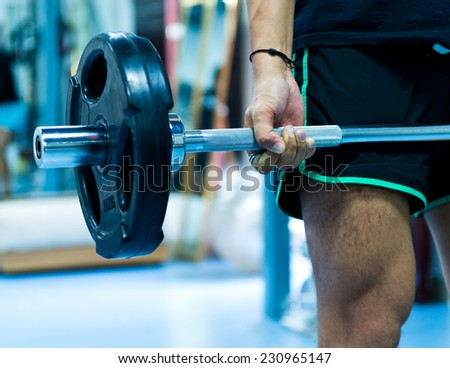 Man with training equipment on sport gym - stock photo
