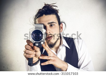 Man with Videocamera - stock photo