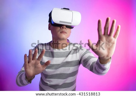 Man with virtual reality glasses showing gesture isolated on a colorful background - stock photo