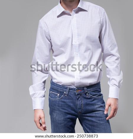 Man with white shirt over dark background - stock photo