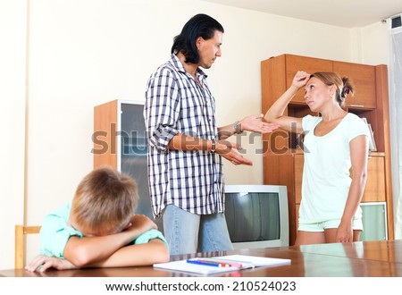 Man with wife and teenage boy having quarrel - stock photo
