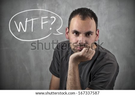 Man with WTF speech bubble - stock photo