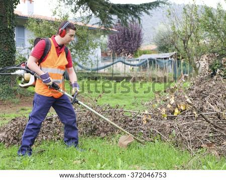 Man working in a garden  - stock photo
