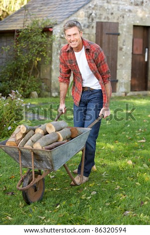 Man working in country garden - stock photo