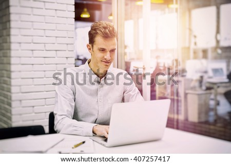 Man working on computer desk in start-up - stock photo