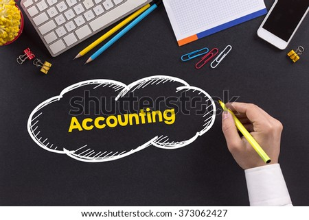 Man working on desk and writing Accounting - stock photo