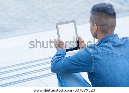 Man working on digital tablet - stock photo