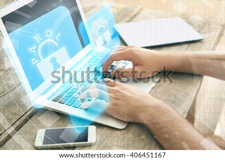 Man working on laptop with icons security on virtual display. Technology, internet and networking concept. - stock photo