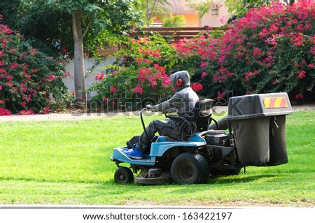 man working on lawn mower - stock photo
