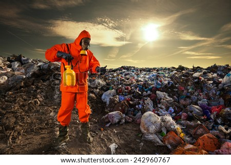 Man working on the landfill - stock photo