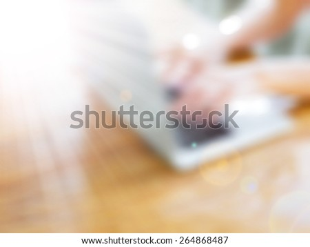 Man working on the laptop at home,abstract blur background for web design,colorful, blurred,texture - stock photo