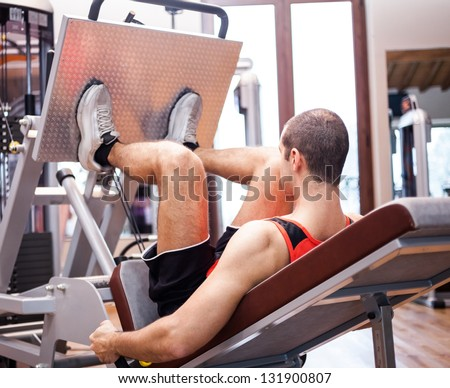 Man working out in a fitness club - stock photo