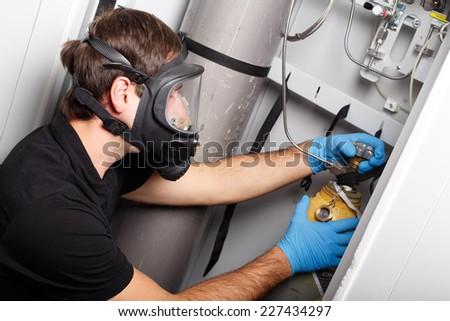 Man working with fluorine gas balloon - stock photo