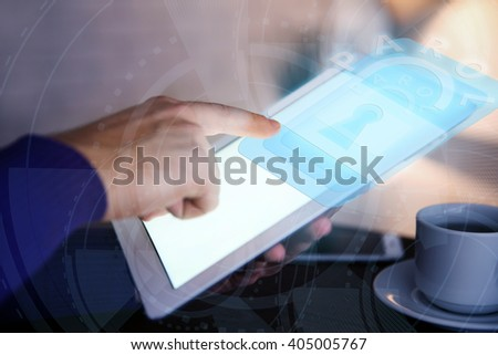 Man working with tablet-pc and icon security on virtual display. Technology, internet and networking concept. - stock photo