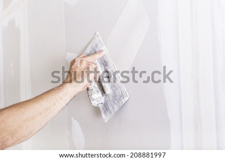 Man working with trowel - stock photo