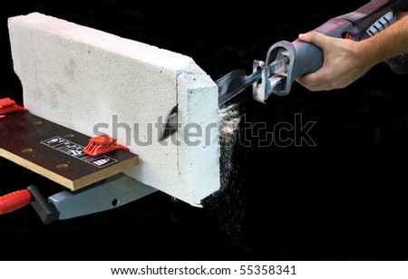 Man works with saber saw - stock photo