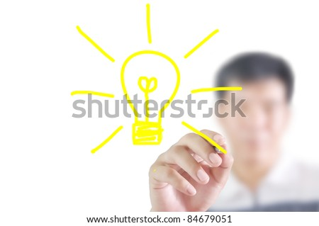 Man write a light bulb - stock photo