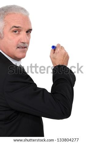 Man writing on white board - stock photo