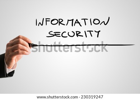 Man writing the word Information security on a virtual screen or interface with a black marker over a light grey background with copyspace. - stock photo