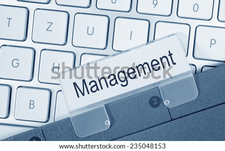 Management - Folder on keyboard in the office - stock photo