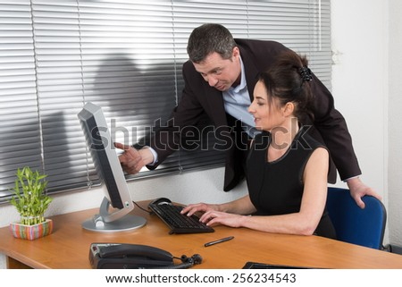 Manager and his secretary working in the office  - stock photo