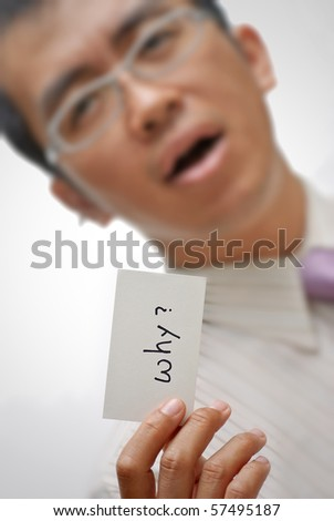 Manager ask you ??why?? and holding one card with words. - stock photo