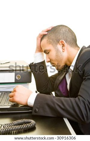 Manager at his desk thinking - stock photo