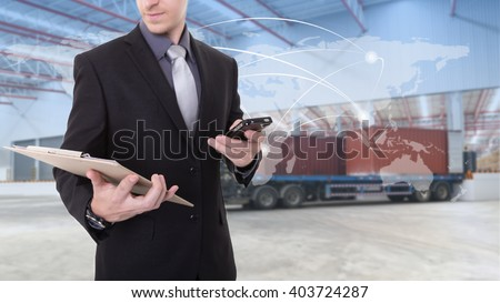 Manager checking plan  at warehouse for Logistic Import Export background (Elements of this image furnished by NASA) - stock photo