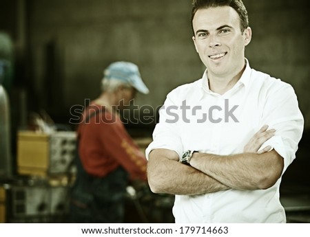 Manager engineering manufacturing industry with metal machines and tools - stock photo
