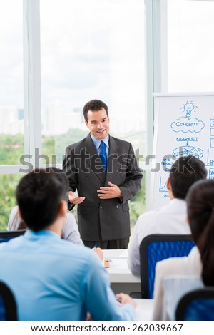 Manager explaining strategy to his employees - stock photo
