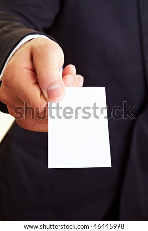 Manager holding an empty white business card - stock photo