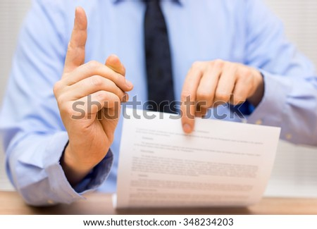 manager is angry at a colleague due to poor document and challenge the operative part of the oral sentence - stock photo