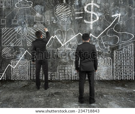 manager looking at businessman drawing business concept doodles on old concrete wall and mottled floor background - stock photo
