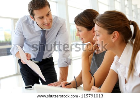 Manager presenting business plan to employees - stock photo