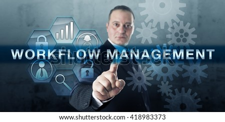Manager pressing WORKFLOW MANAGEMENT on a virtual touch screen interface. Business concept for the structured organization of resources, processing of information and performance monitoring software. - stock photo