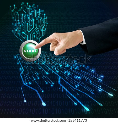 Manager pushing start button for starting circuit board system - stock photo