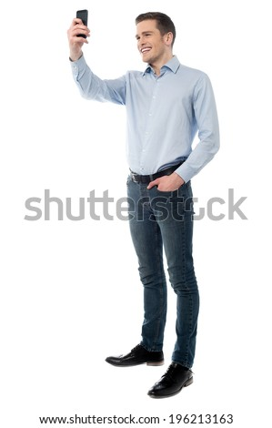 Manager taking pictures with his smartphone - stock photo