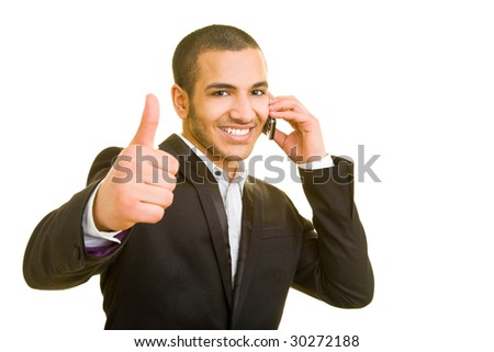 Manager using cell phone and holding thumb up - stock photo