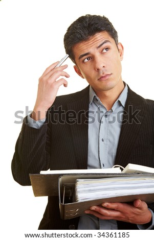 Manager with files in his hands scratches his head while thinking - stock photo