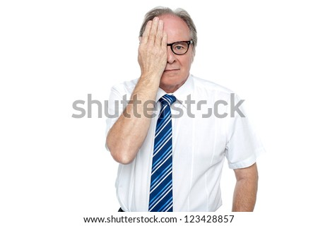 Manager with hand on right eye looking at you isolated against white background. - stock photo